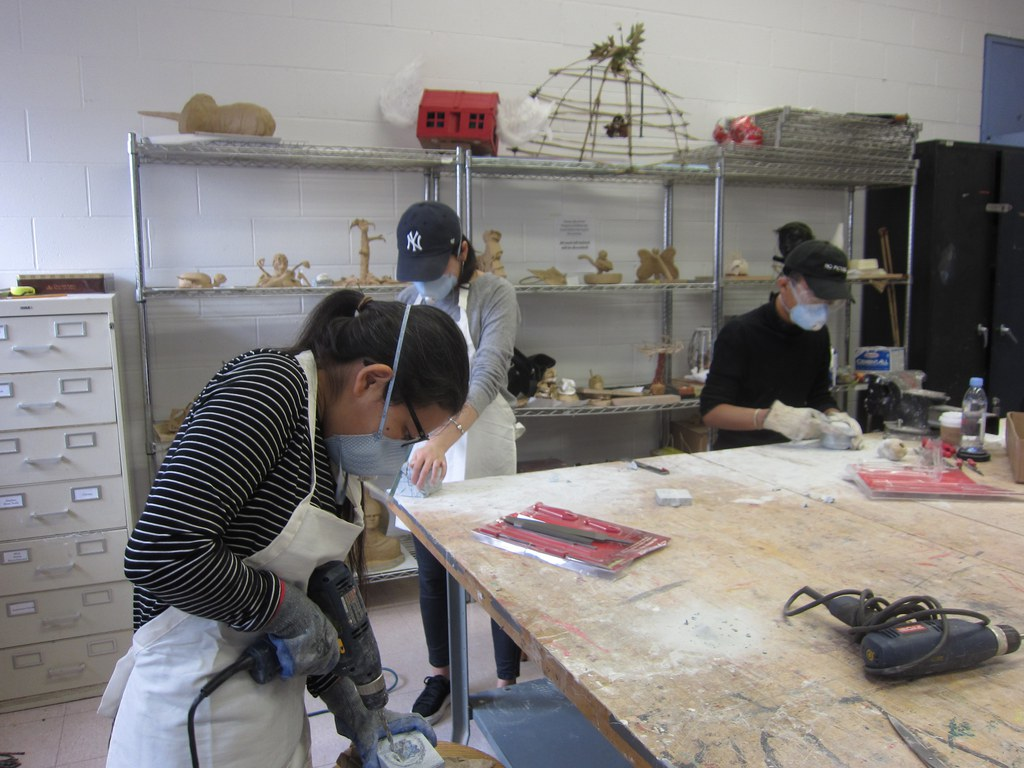 Department of Performing and Fine Arts students working during a sculpture class.