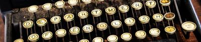 Typewriter with keys spelling Department of English